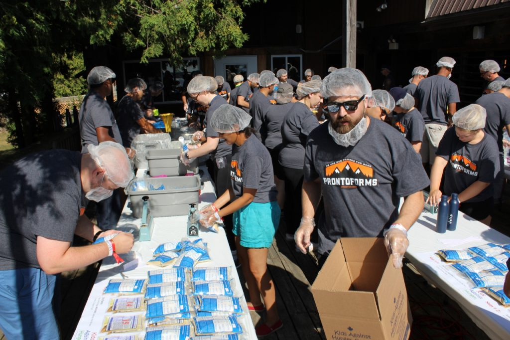 ProntoForms employees packing meals for Kids Against Hunger Canada